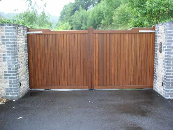 Деревянные ворота на металлическом каркасе в гараж замки на гараж где купить